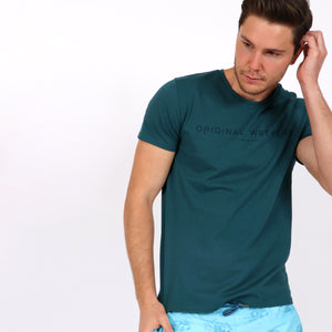 OWTS1802 Atlantic Green men's organic cotton t-shirt with logo print on body front view styled