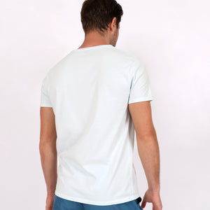 OWTS1804 Ice Blue garment dyed beach fit men's organic cotton t-shirt with chest pocket detail on body back view