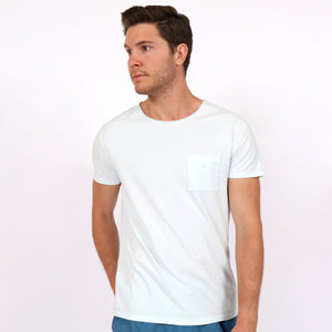 OWTS1804 Ice Blue garment dyed beach fit men's organic cotton t-shirt with chest pocket detail on body front view