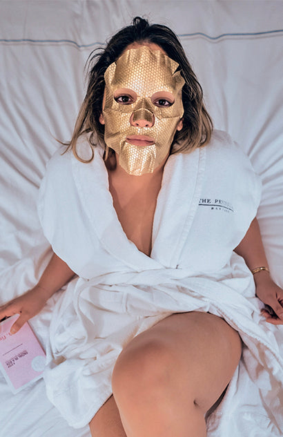 The Lift + Firm Mask, part of the Makeover Sheet Masks from sfglow applied on a skin.