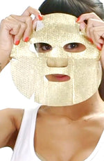 A woman applies the Lift + Firm Facial Kit, from sfglow
