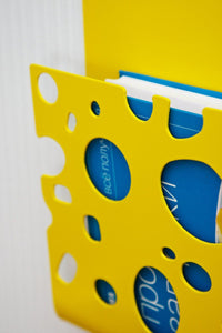 Decorative rack shelf for magazines or books Swiss Cheese laser cut powder coated steel - Design Atelier Article