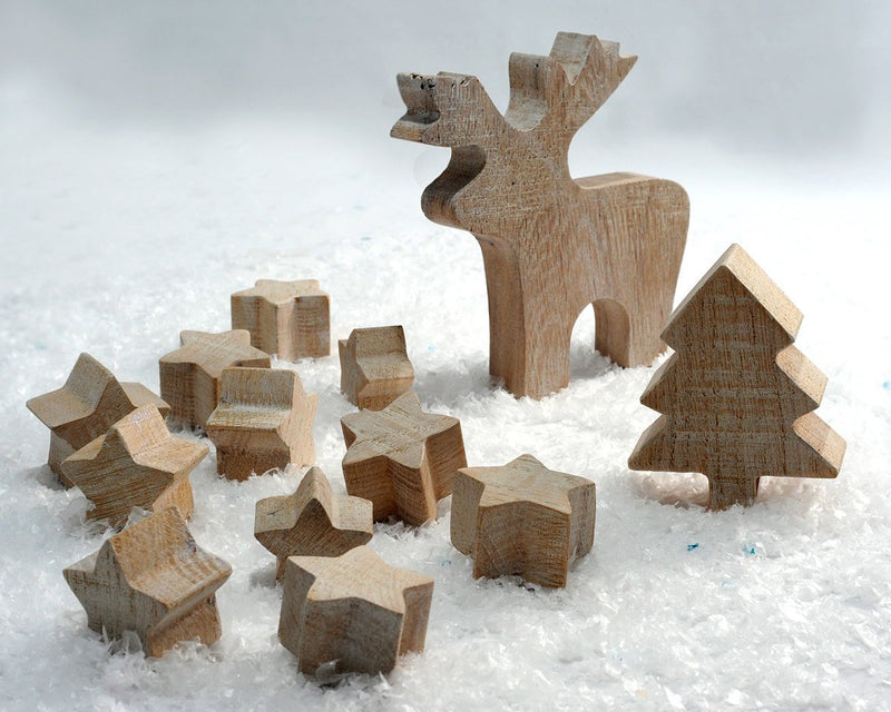 Christmas wooden ornaments . 11 stars, one moose and a tree. By Atelier Article