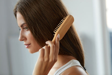 GNA Naturals Stock Image Women Brushing Hair