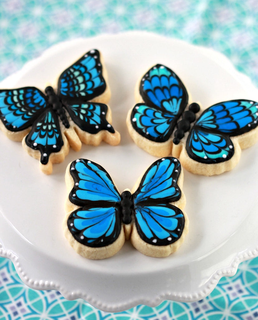 blue butterfly cookies sweetopia ben solos sweater reylo Friday apparel Star Wars party ideas
