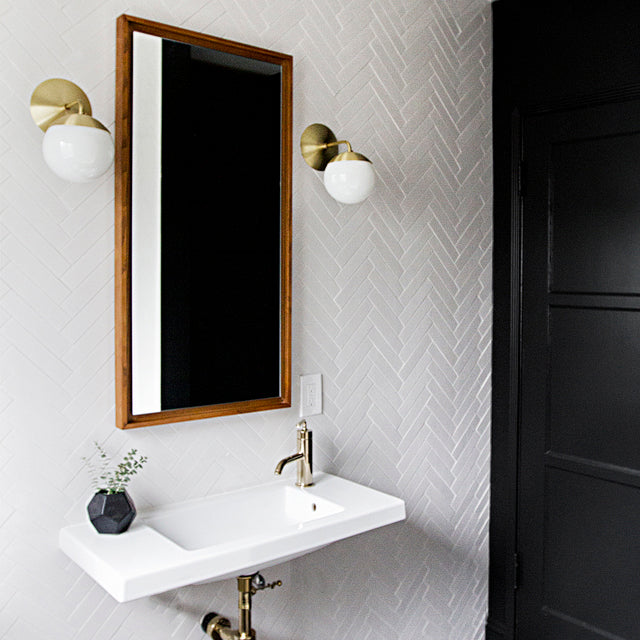 "Interior Design By Sarah Sherman Samuel. Featuring Alto Sconce 6"" in Brass and Opal."