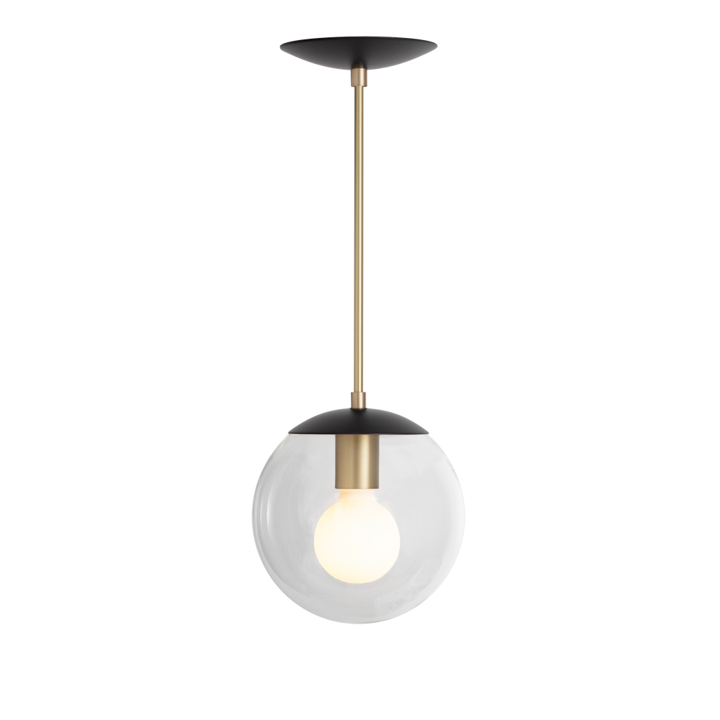 "Alto Rod Pendant. Shown in Matte Black + Brass Finish with 8"" Opal Glass. Cedar and Moss."