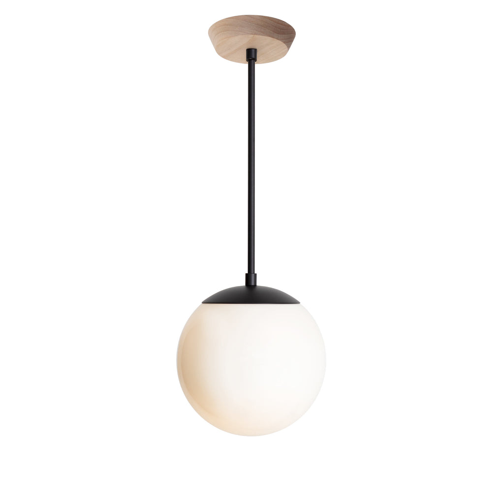 "Alto Rod Pendant with 8"" Opal glass. Shown in Matte Black finish with Birch wood canopy. (G25 light bulb shown, not included). Cedar and Moss."