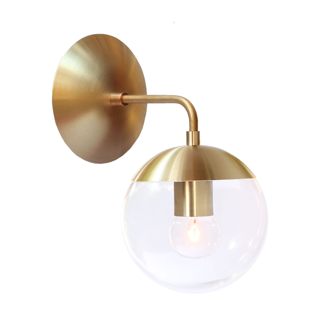 "Cedar and Moss. Alto Sconce 6"". Shown in brass finish with clear glass. (G16.5 light bulb shown, not included)."
