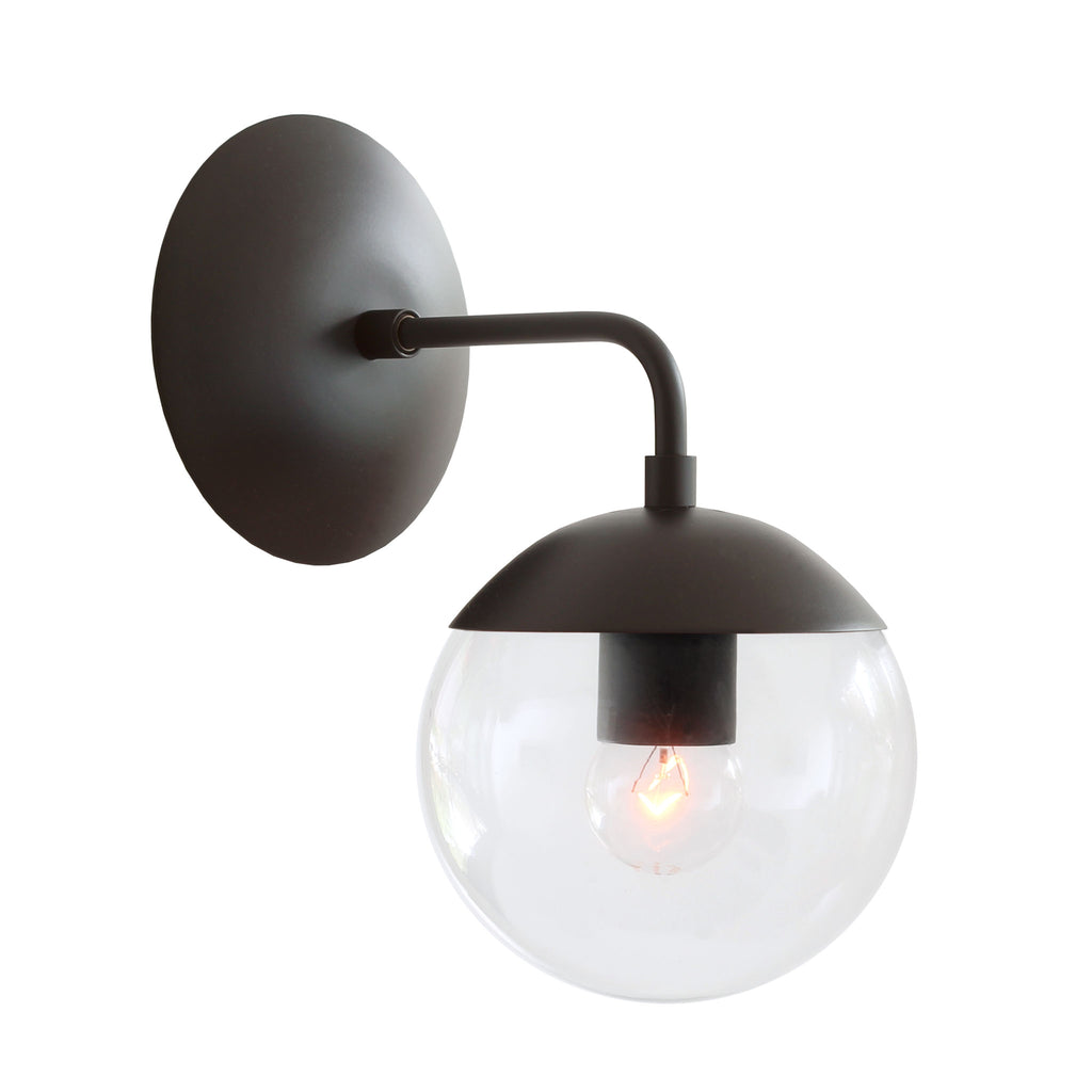 "Cedar and Moss. Alto Sconce 6"". Shown in matte black finish with clear glass. (G16.5 light bulb shown, not included)."