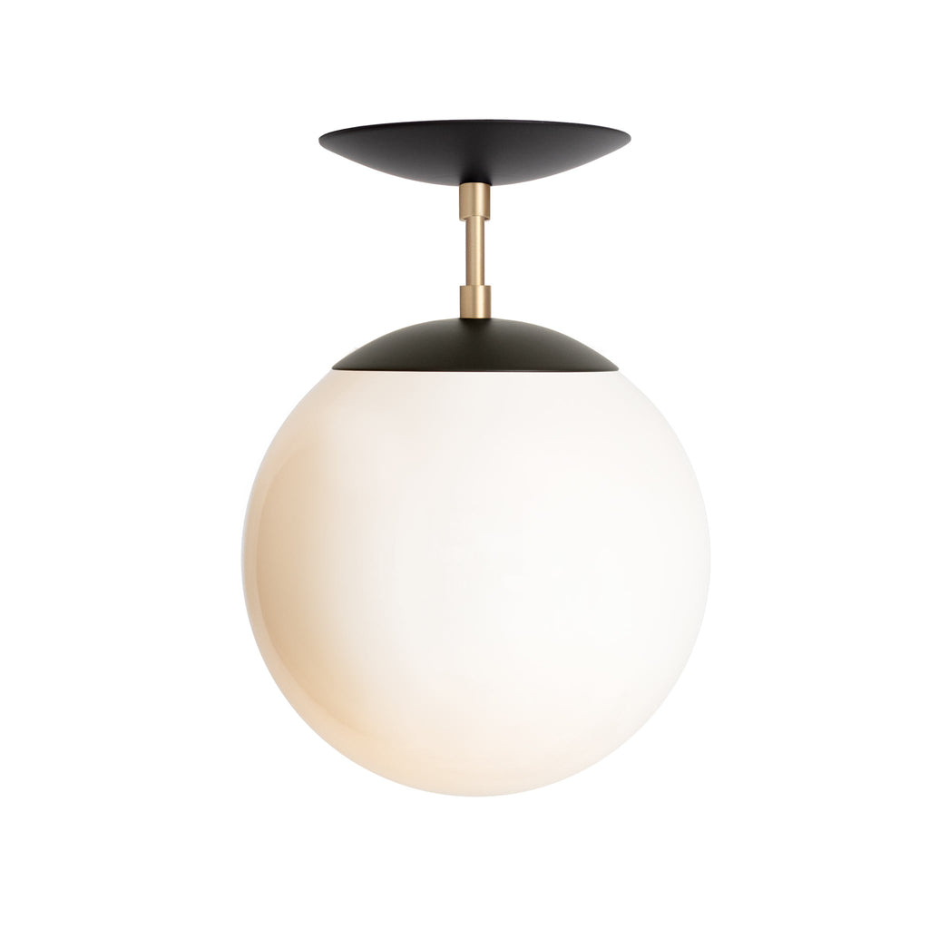 "Alto Surface 10"". Shown in Matte Black + Brass finish with 10"" Opal Glass Globe. (G25 light bulb shown, not included). Cedar and Moss."