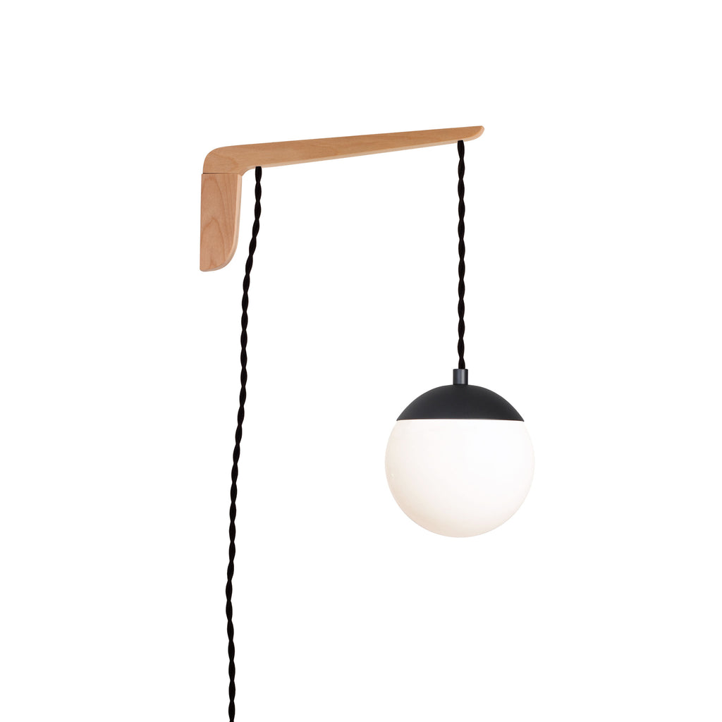 "Swing Arm Alto 6"". Shown with Matte Black, Birch wood, and Black twisted cord. (A15 light bulb shown, not included). Cedar and Moss."