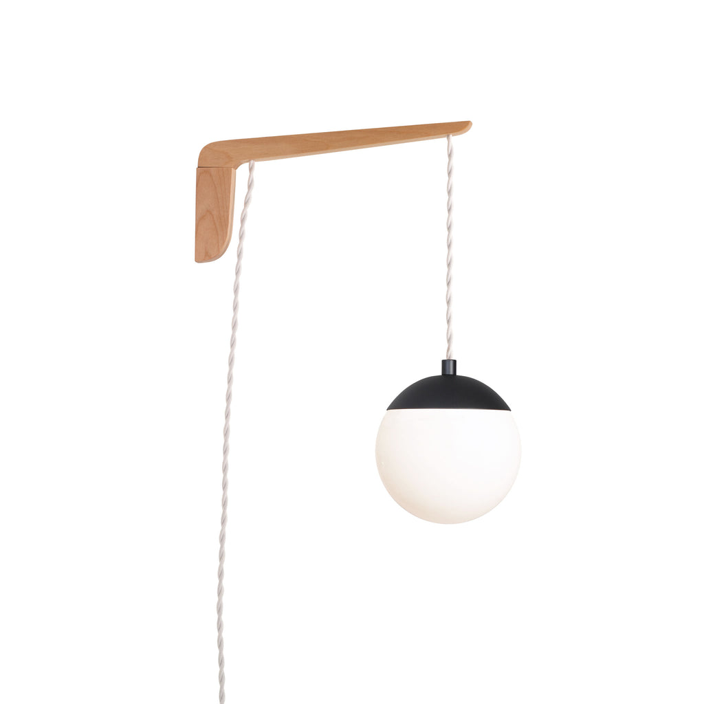"Swing Arm Alto 6"". Shown with Maple wood arm, Matte Black metal finish, and White cord. (A15 light bulb shown, not included). Cedar and Moss."