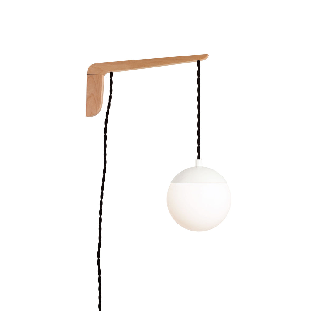 "Swing Arm Alto 6"". Shown with Maple wood arm, White metal finish, and Black cord. (A15 light bulb shown, not included). Cedar and Moss."