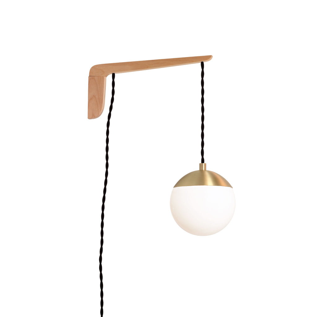 "Swing Arm Alto 6"". Shown with Maple wood arm, Brass metal finish, and Black cord. (A15 light bulb shown, not included). Cedar and Moss."
