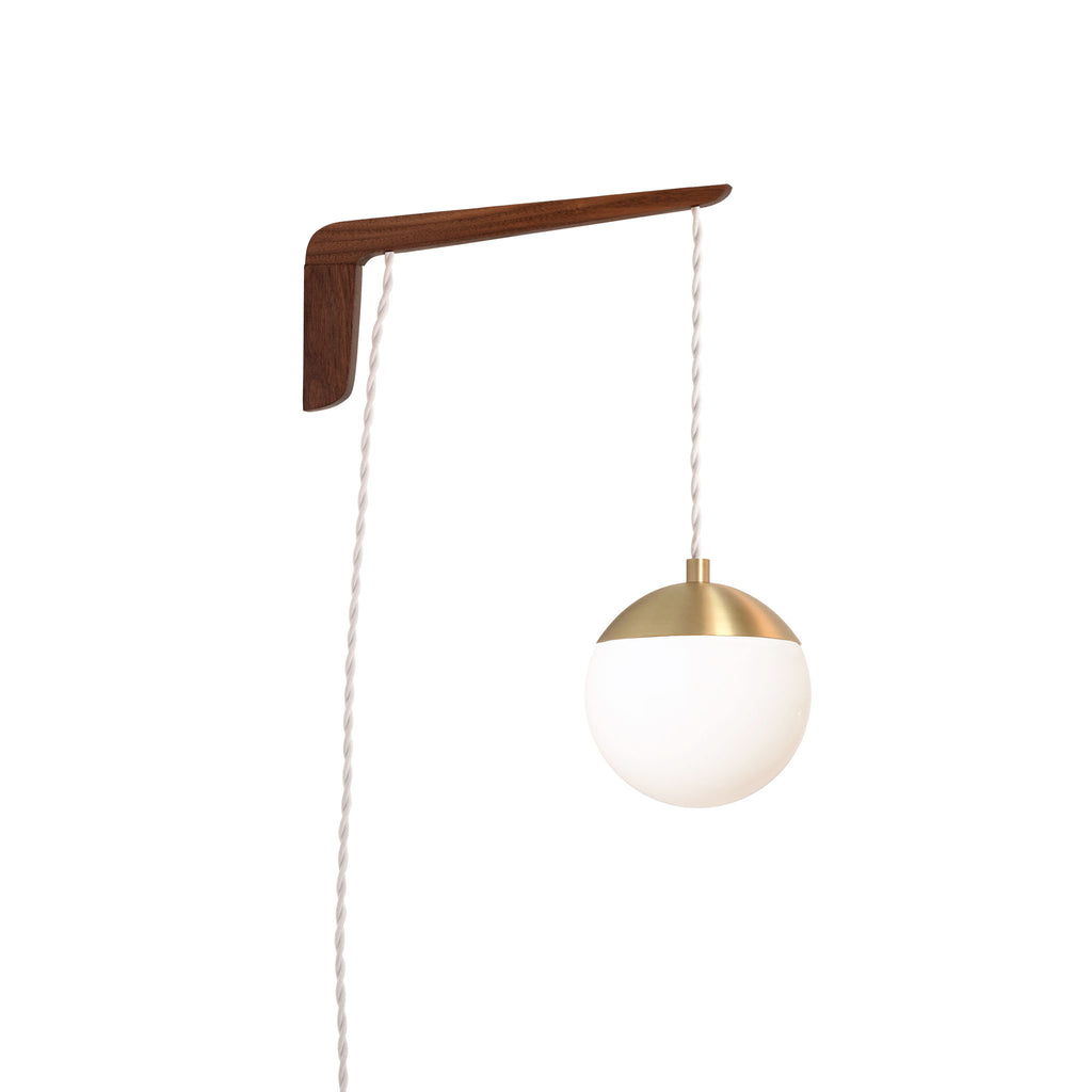"Swing Arm Alto 6"". Shown with Walnut wood arm, Brass metal finish, and White cord. (A15 light bulb shown, not included). Cedar and Moss."