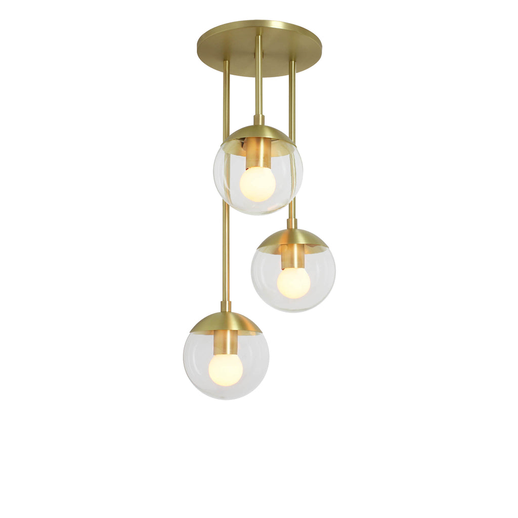"Alto Waterfall. Shown at 25"" length in Brass finish with (3) 6"" Clear Glass Globes. (G19 light bulb shown, not included)."
