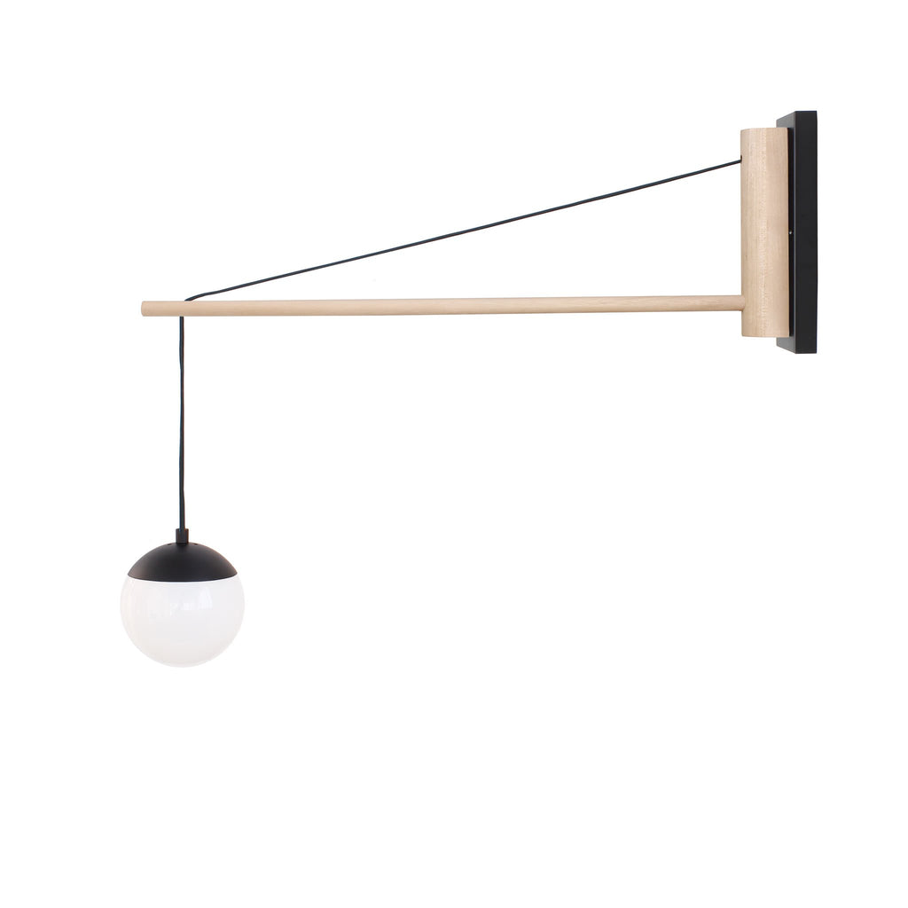 "Cedar and Moss. Alto 30"" Wood Arm Sconce, Hardwired. Shown in Matte Black finish with birch wood and 6"" opal glass. (G16.5 bulbs shown, not included)."