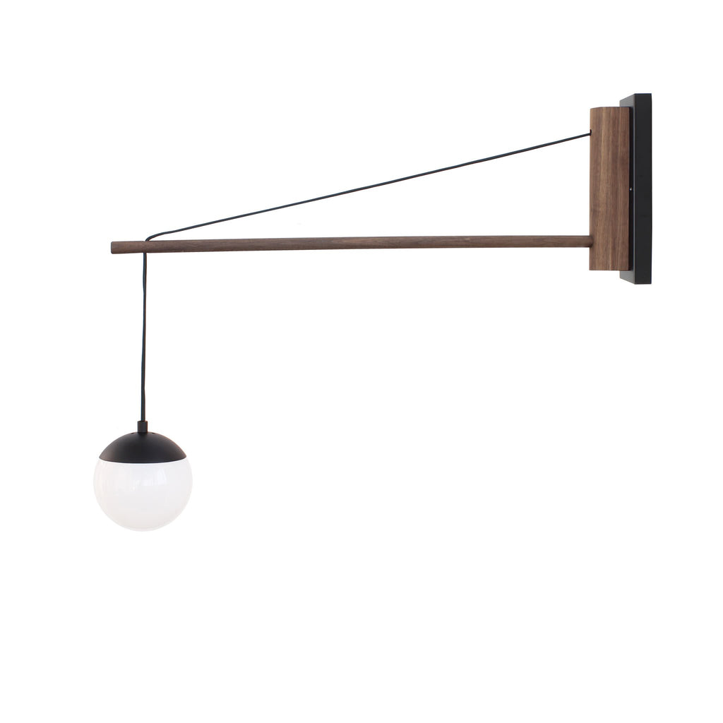 "Cedar and Moss. Alto 30"" Wood Arm Sconce, Hardwired. Shown in matte black finish with walnut wood and 6"" opal glass. (G16.5 bulbs shown, not included)."