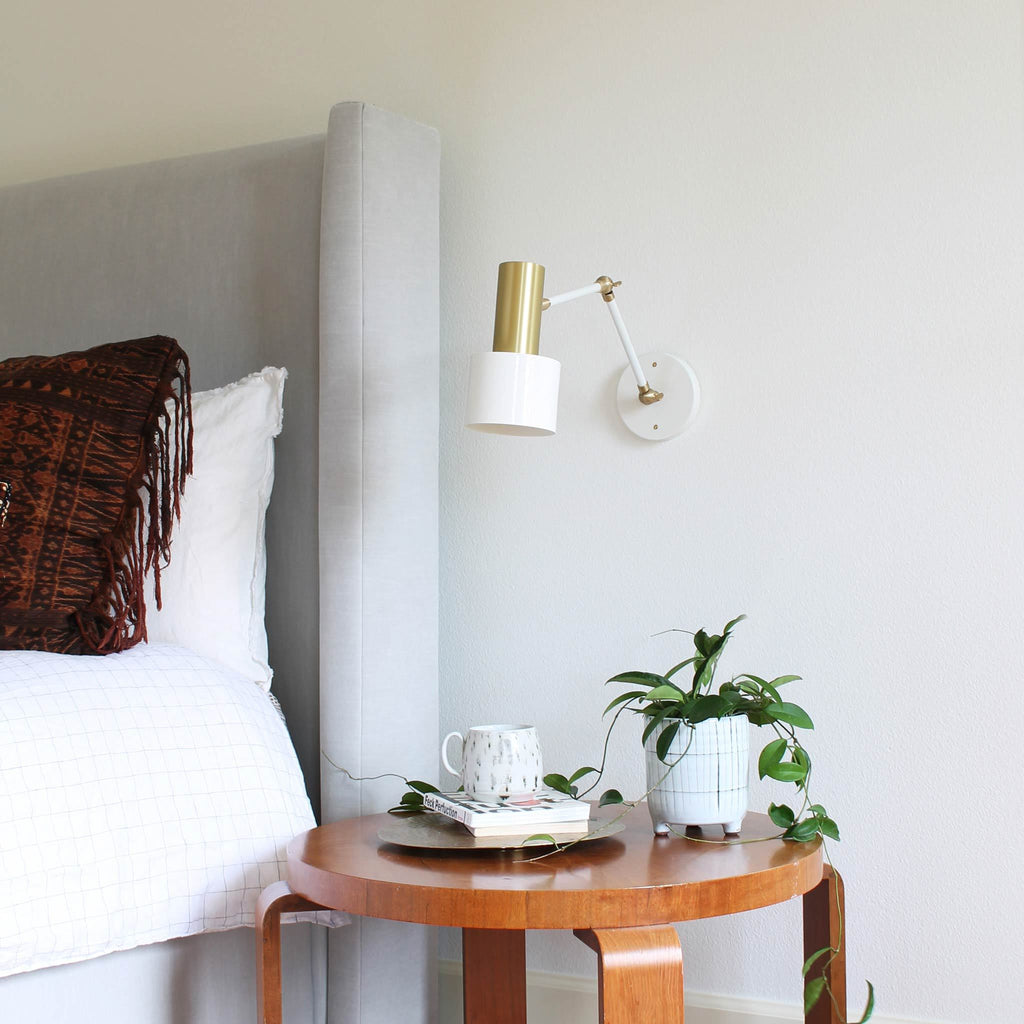 Articulated Ridge Sconce in white + brass by Cedar & Moss