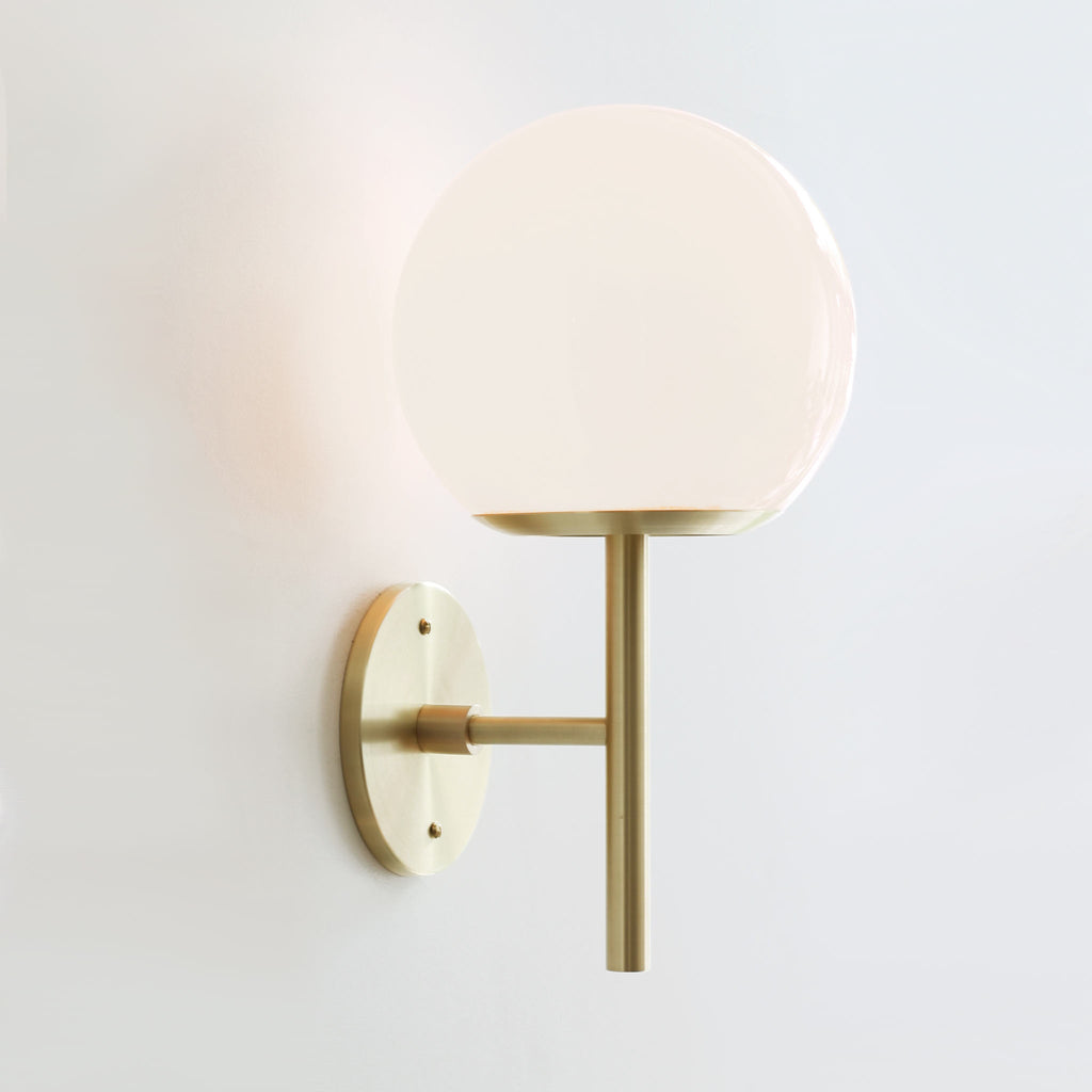 "Athena 8"" Wall Sconce. Shown in Brass finish with Opal glass. Cedar and Moss."