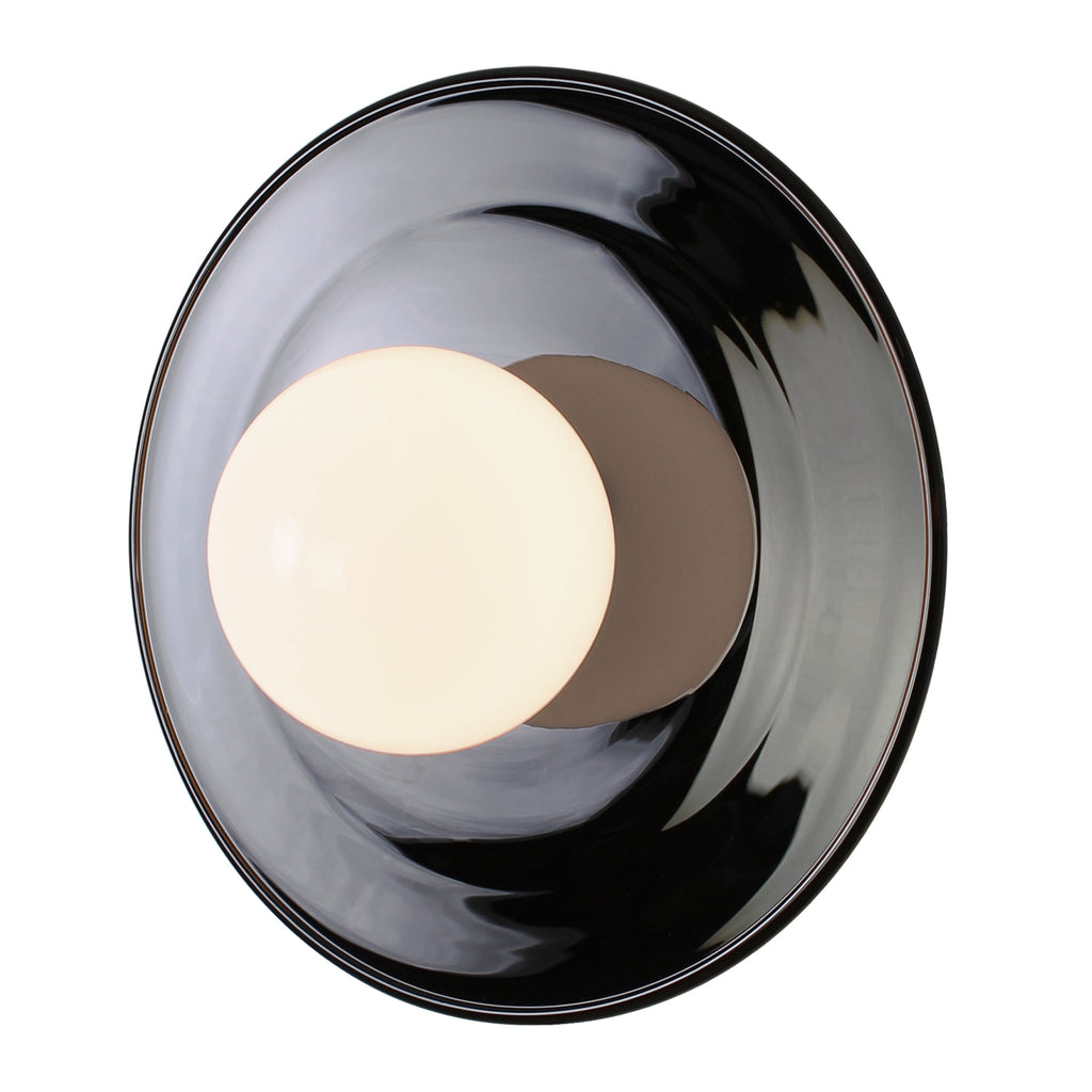 Ella Sconce. Mouth-blown black glass reflector. Cedar and Moss.