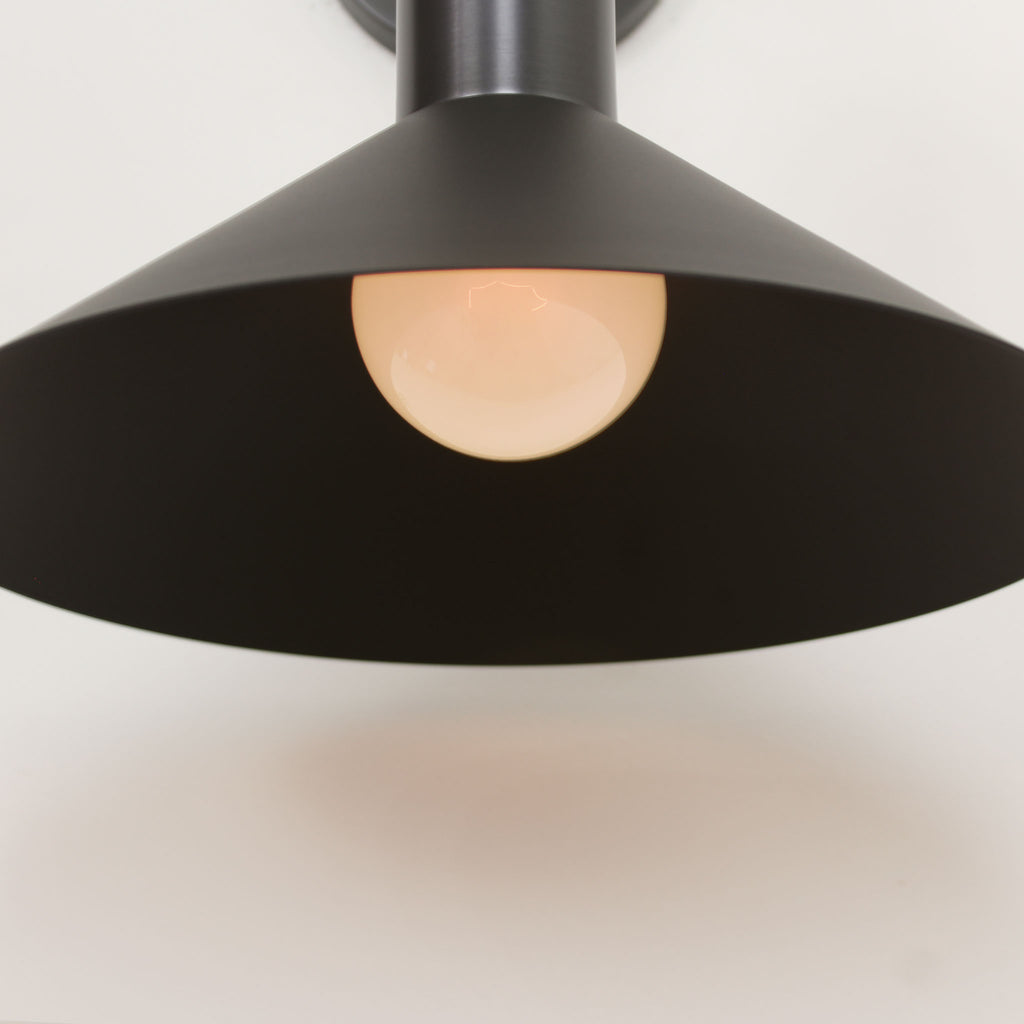 Cedar and Moss. Juniper Sconce. Shown in Matte Black and Graphite Patina finish. (G25 light bulbs shown, not included).