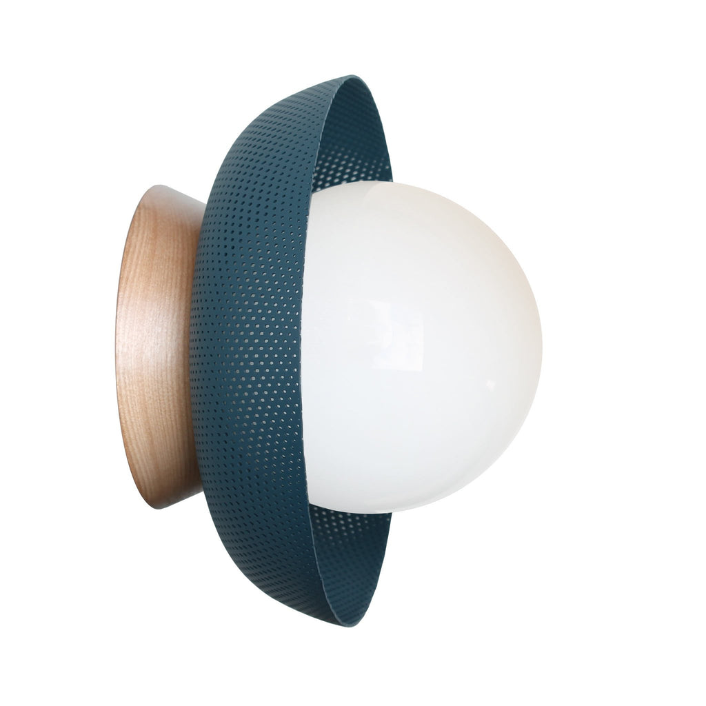 Lexi Surface or Sconce. Shown in Ocean Blue finish with Birch wood canopy upgrade and Opal Glass. Cedar and Moss.