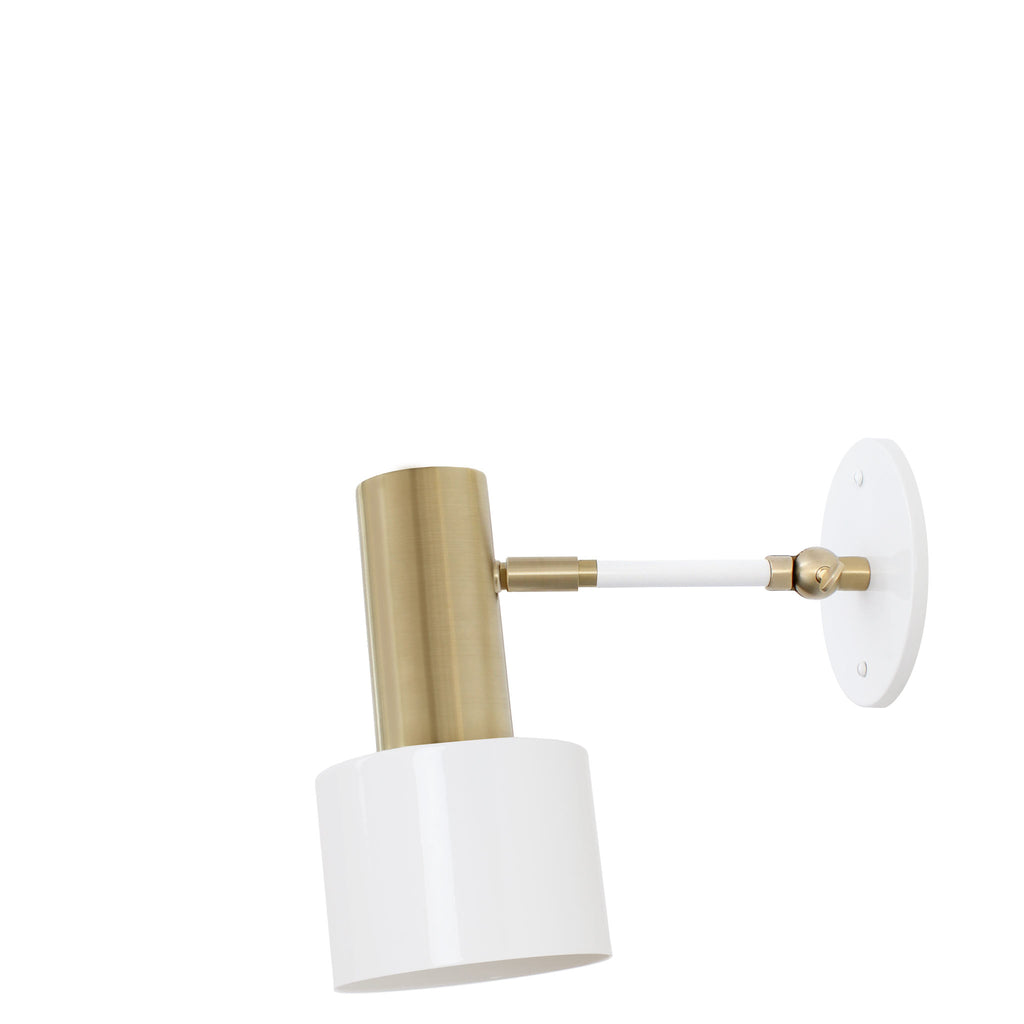 Ridge Single Articulated Sconce. Shown in White + Brass finish. (A19 bulb shown, not included). Cedar and Moss.