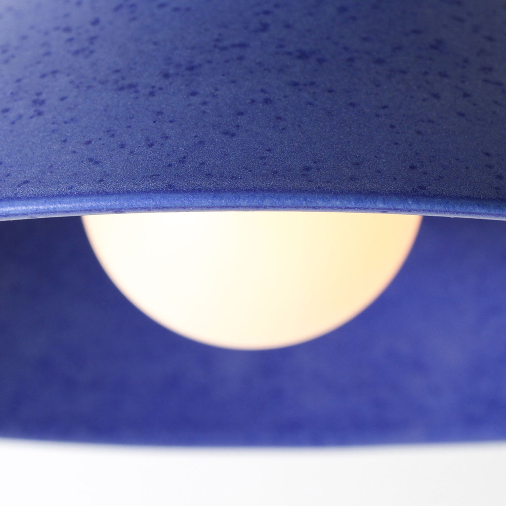 Sophie Surface. Shown in Cobalt Blue ceramic. (Tala Sphere II LED light bulb shown, not included). Cedar and Moss.
