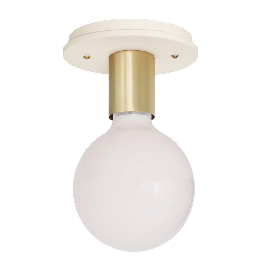 Swift Surface or Sconce. Shown with Brass metal socket cup and Ceramic Bone canopy. (G40 light bulb shown, not included). Cedar and Moss.