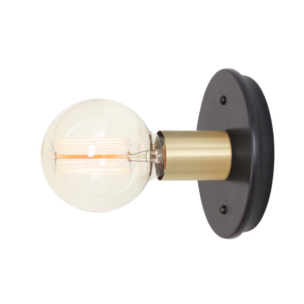 Swift Surface or Sconce. Shown with Brass metal socket cup and Ceramic Eclipse Black canopy. (G30 Edison light bulb shown, not included). Cedar and Moss.