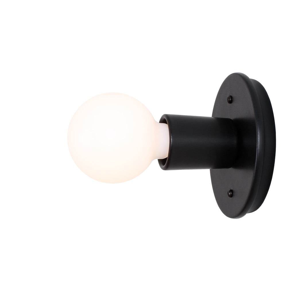 Swift Surface or Sconce. Shown in Eclipse Black finish. (G25 Tala Bulb shown, not included). Cedar and Moss.