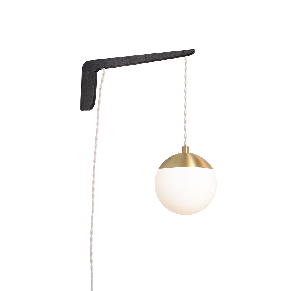 "Swing Arm Alto 6"". Shown with Black Stained wood arm, Brass metal finish, and White cord. (A15 light bulb shown, not included). Cedar and Moss."