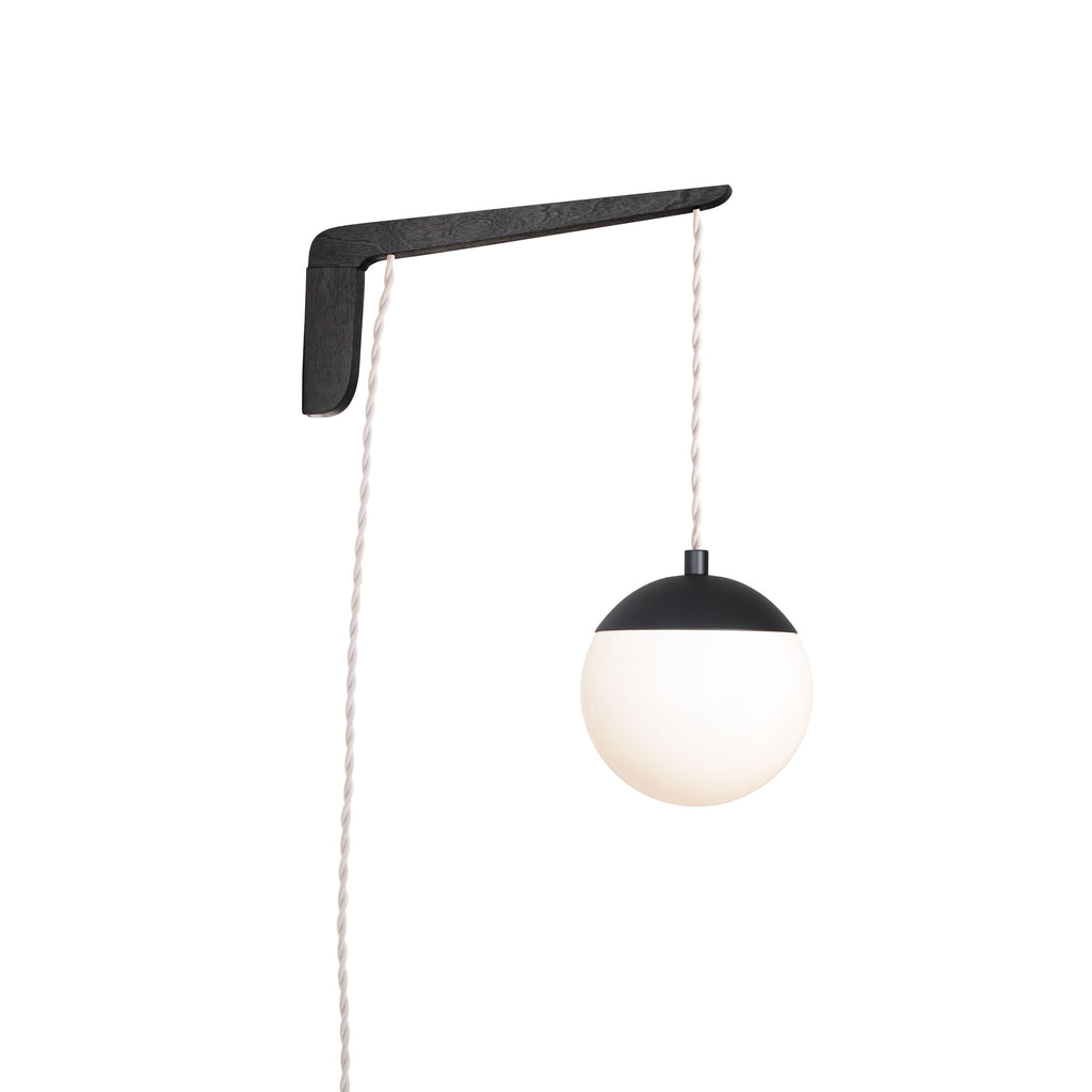 "Swing Arm Alto 6"". Shown with Black Stained wood arm, Matte Black metal finish, and White cord. (A15 light bulb shown, not included). Cedar and Moss."