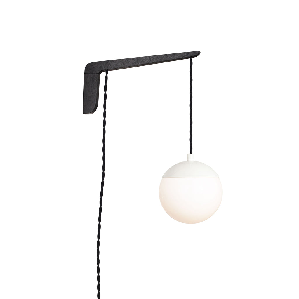 "Swing Arm Alto 6"". Shown with Black Stained wood arm, White metal finish, and Black cord. (A15 light bulb shown, not included). Cedar and Moss."