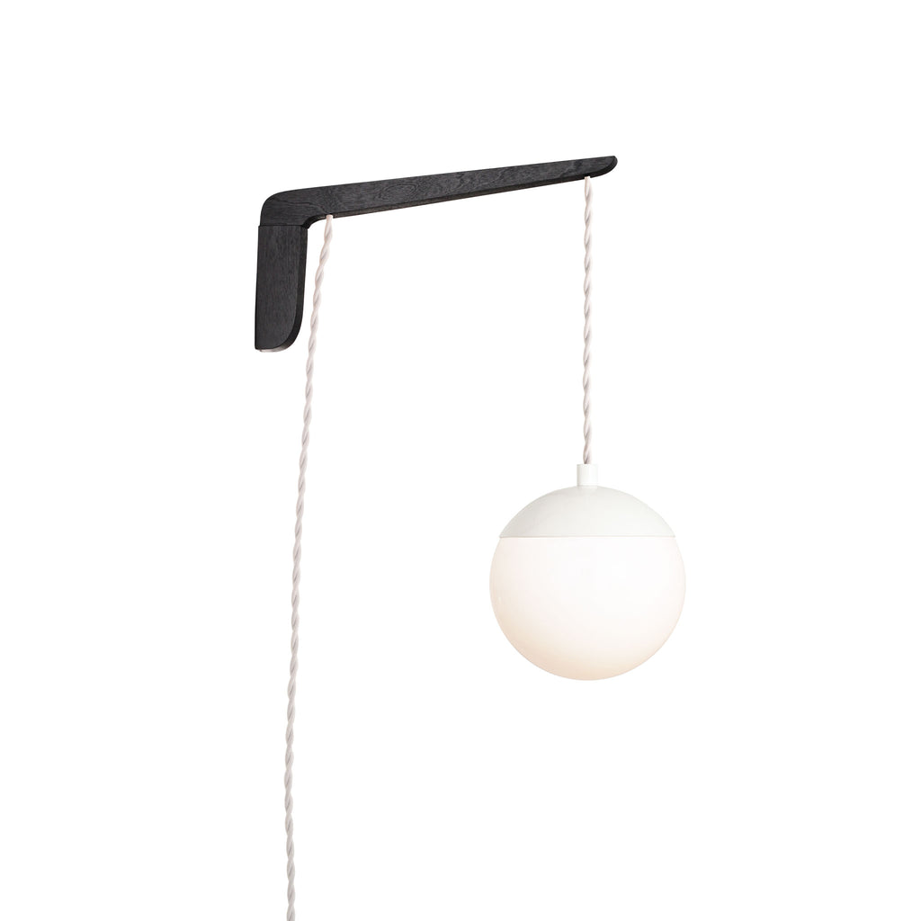 "Swing Arm Alto 6"". Shown with Black Stained wood arm, White metal finish, and White cord. (A15 light bulb shown, not included). Cedar and Moss."