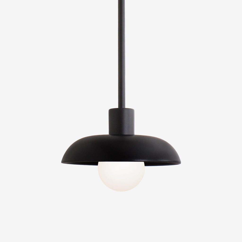 Terra Pendant. Shown with Eclipse Black ceramic and Matte Black metal finish. (G25 light bulb shown, not included). Cedar and Moss.