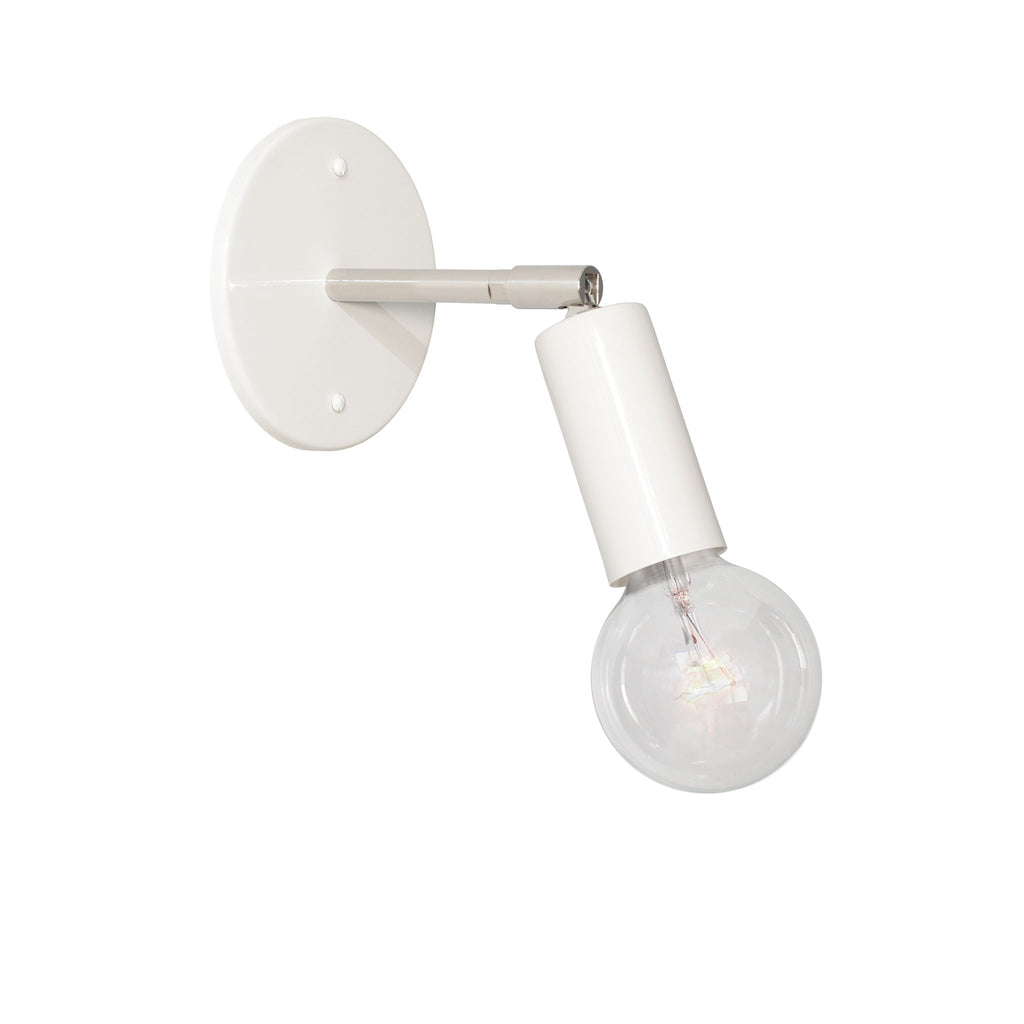 "Tilt Sconce. Shown in White + Polished Nickel Finish with 3"" arm. (G25 light bulb shown, not included). Cedar and Moss."
