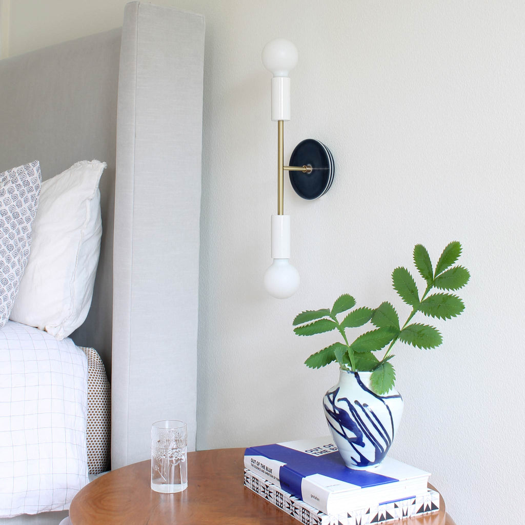 Venus Sconce in white + brass with a Swift Design Ceramic Canopy in Indigo Blue by Cedar & Moss