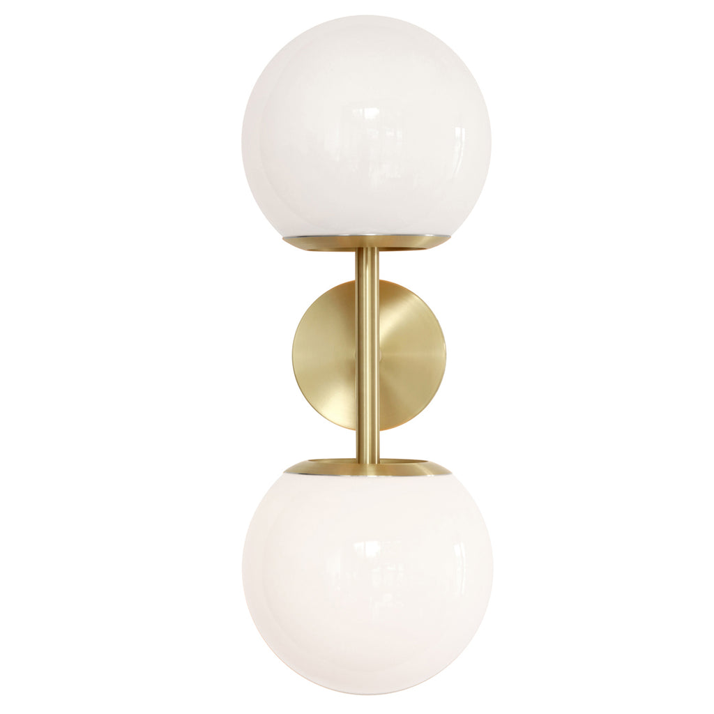 "Cedar and Moss. Juno 8"" Double Globe Wall Sconce. Shown in Brass with Opal glass. (G19 light bulbs shown, not included)."