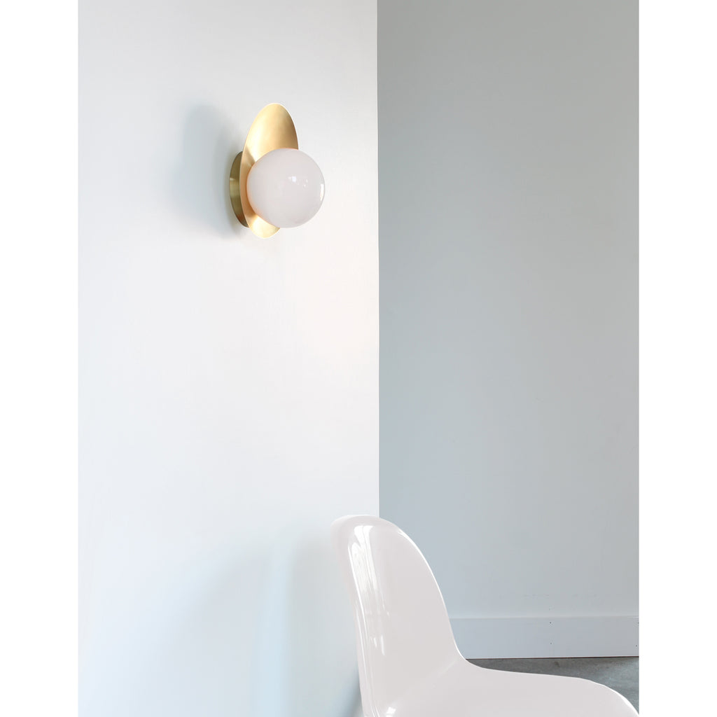 Cedar and Moss. Pearl Wall Sconce. Shown in Brass finish.