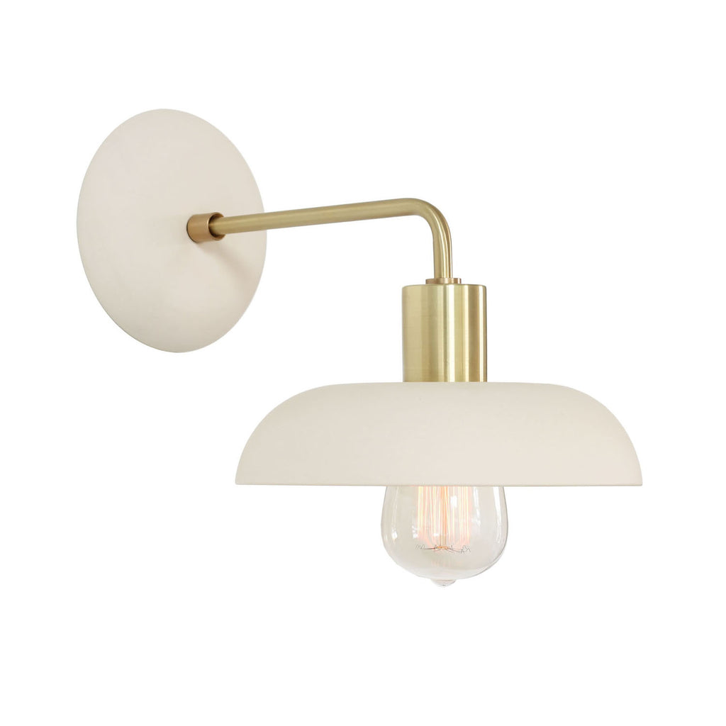 Terra Sconce shown in Bone Ceramic finish. Radius canopy design shown here. Cedar and Moss.