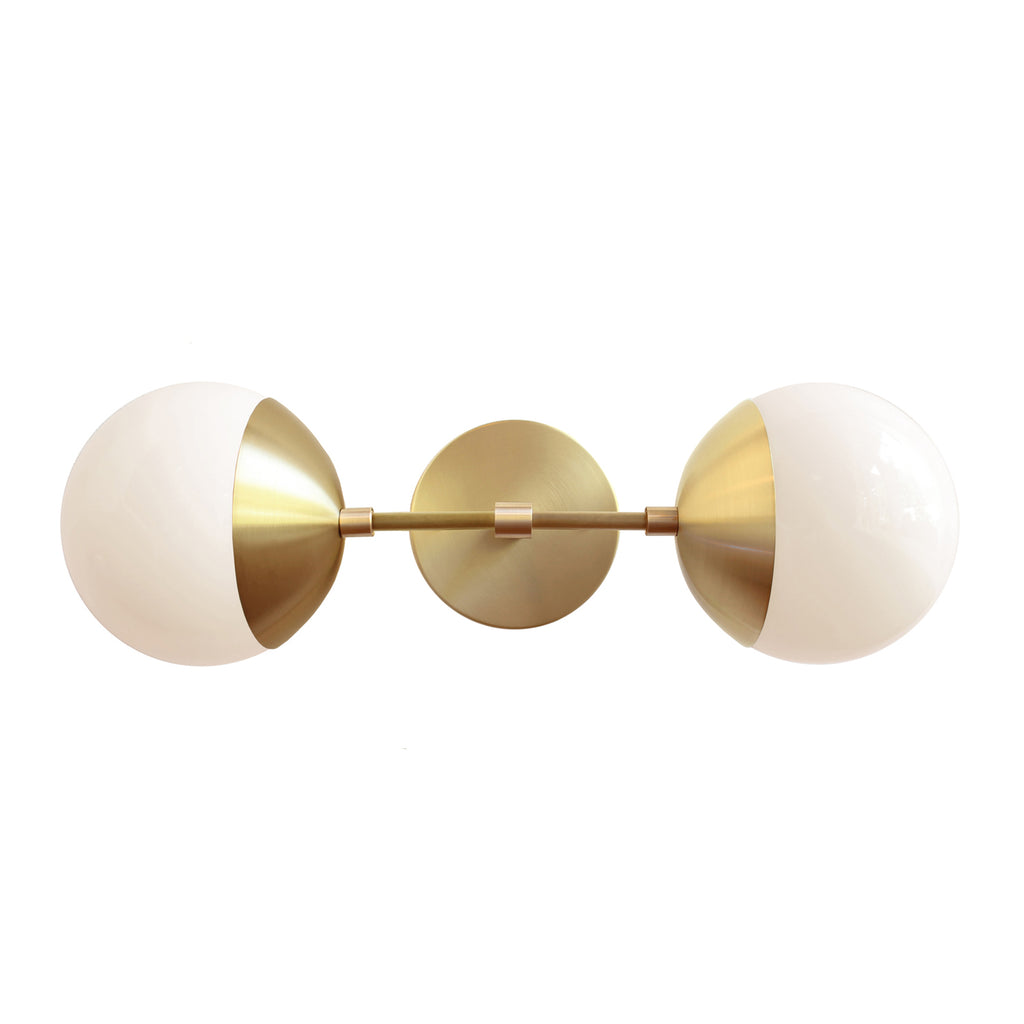 "Cedar and Moss. Theo 6"" sconce. Shown in brass finish. (G16.5 light bulbs shown, not included)."