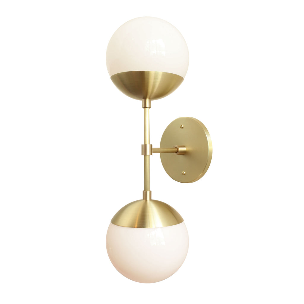 "Theo Sconce with 6"" Opal glass. Shown in Brass finish. (G16.5 light bulbs shown, not included). Cedar and Moss."