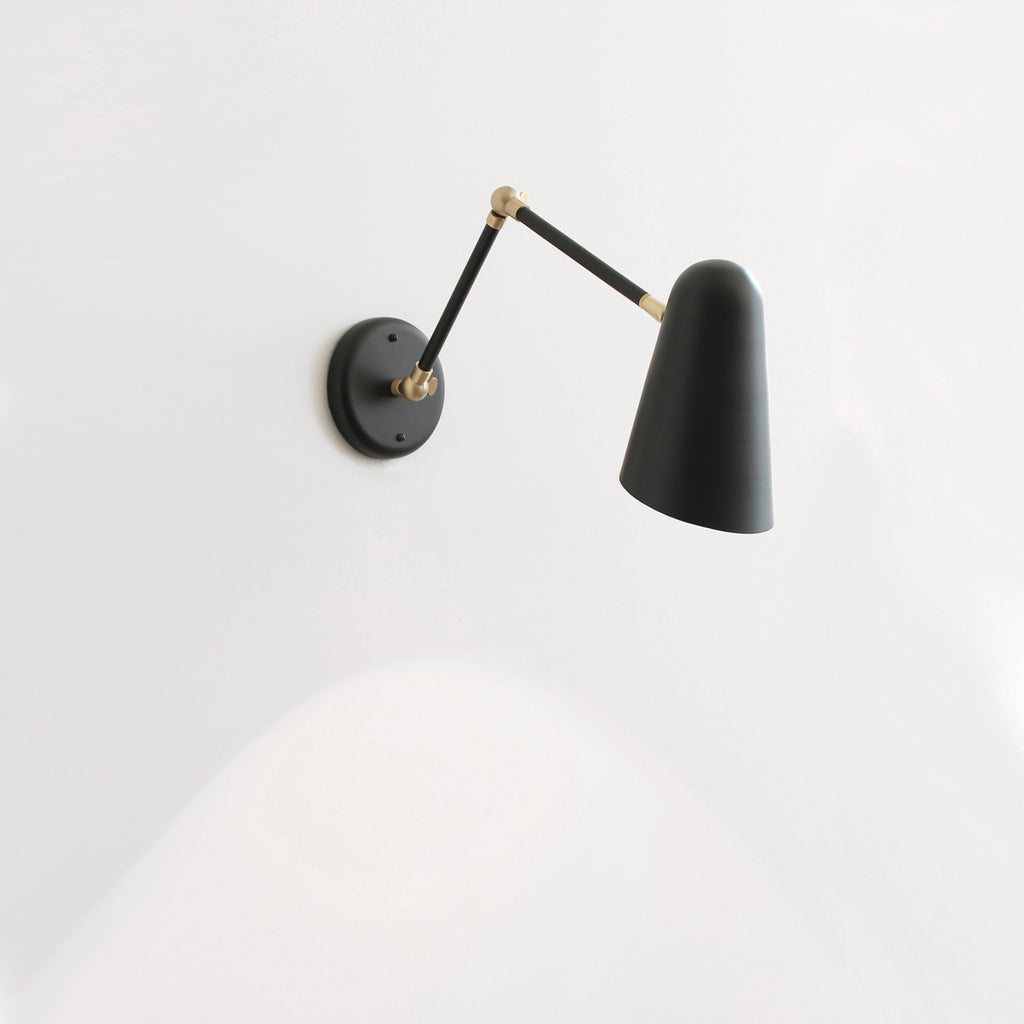 Cedar and Moss. Articulated Wildwood Sconce. Shown in Matte Black Finish with Brass Small Parts.