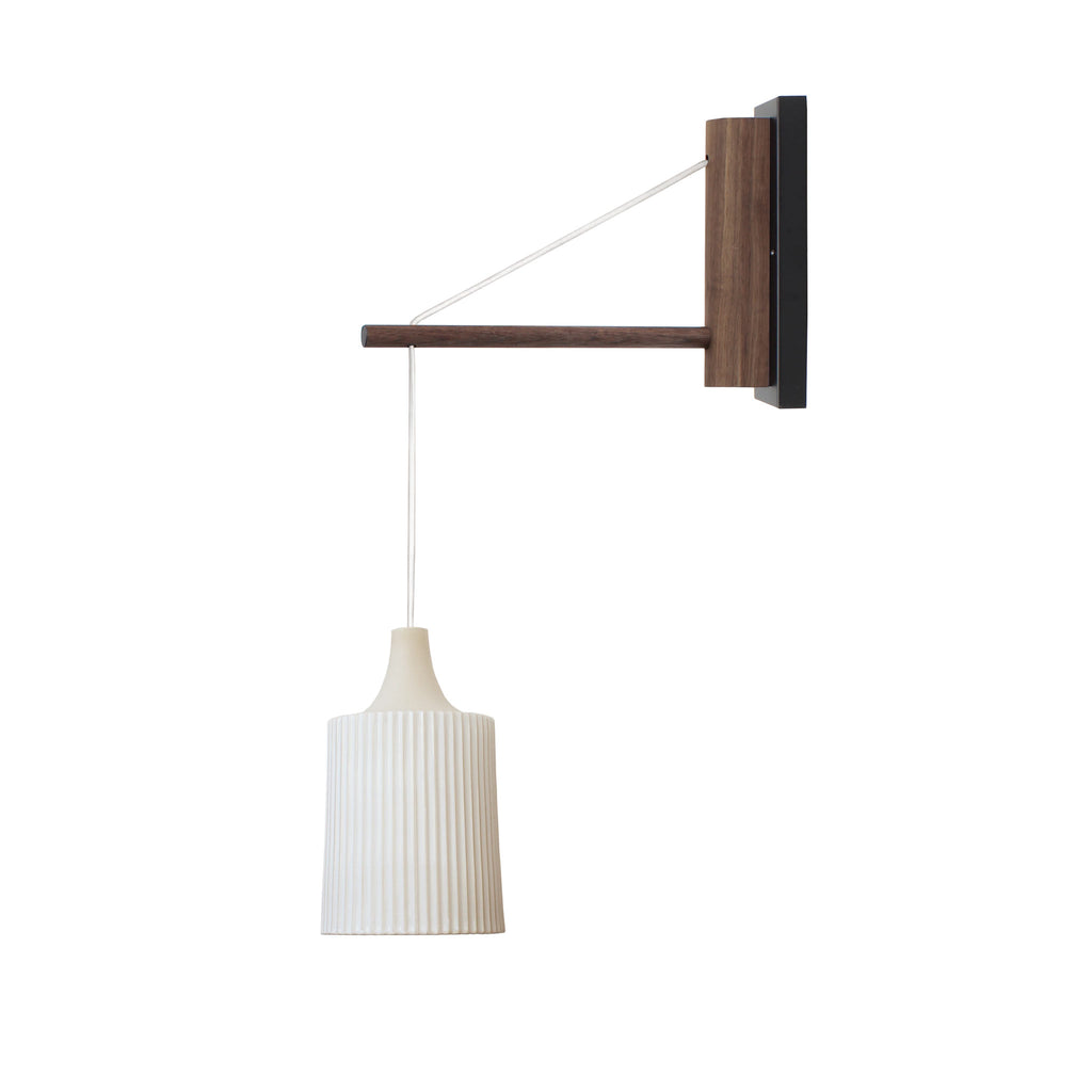 "Tumwater 14"" Wood Arm Hardwired Wall Sconce. Shown in Walnut and Matte Black with white cord. Cedar and Moss."