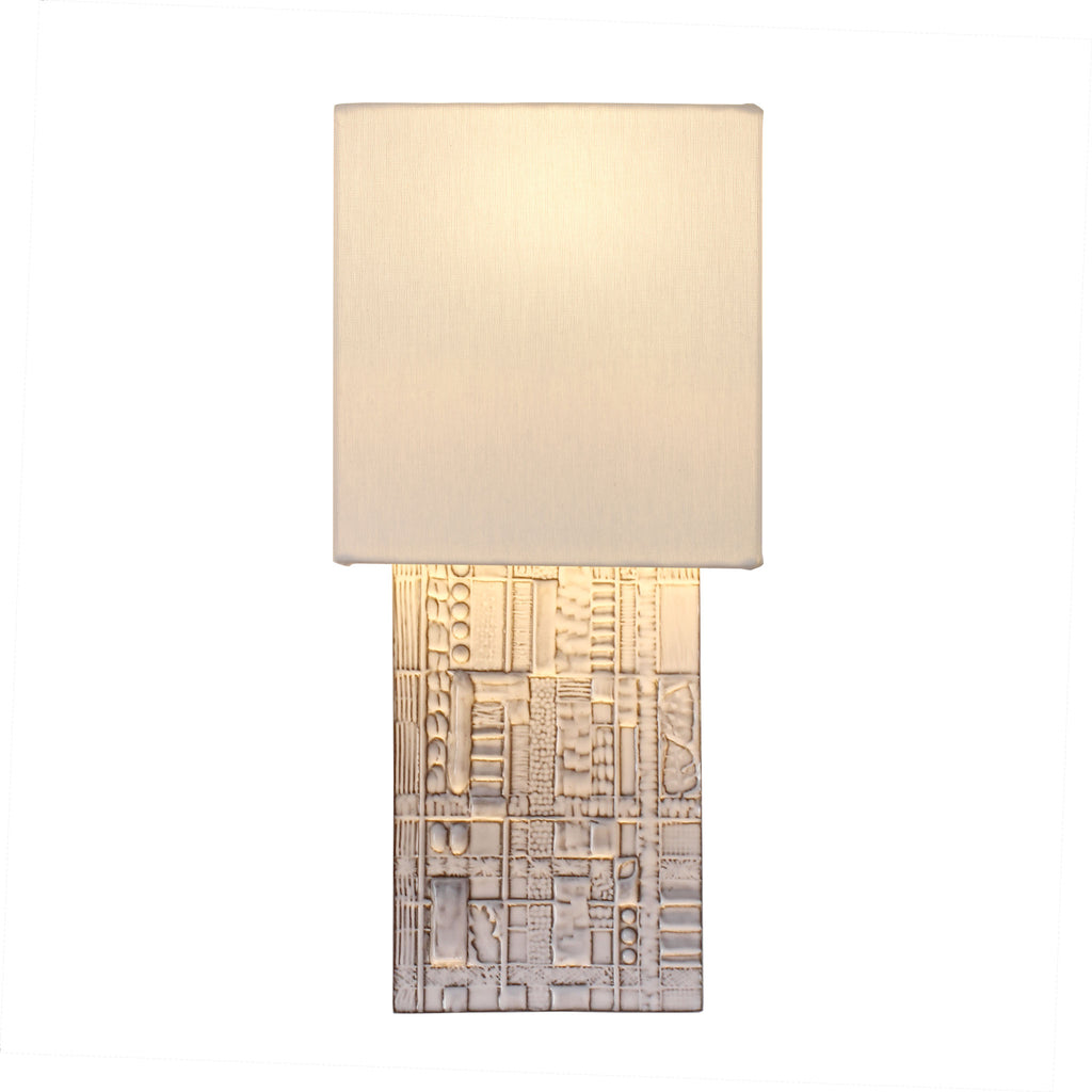 Izzy Sconce. Shown in Brownstone White ceramic. Cedar and Moss.