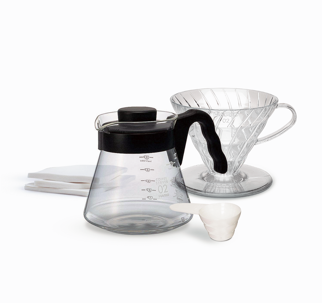 Hario pour over kit including carafe, paper filters, pour over, and coffee bean scoop available at Sly and Sons Coffee Roasters