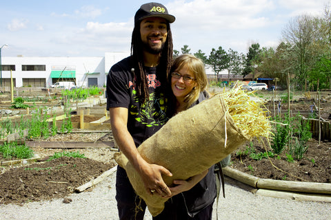 Young Agrarians, two people holding a bag of cover crop